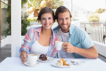 Happy couple enjoying coffee together