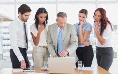 Business team using a laptop