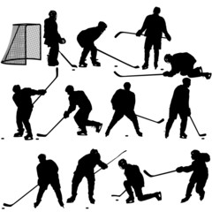 Set of silhouettes of hockey player. Isolated on white.