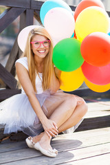 Young beautiful woman with balloons