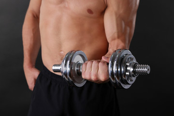 Muscle young sportsman execute exercise with dumbbell
