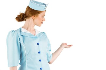 Pretty air hostess presenting with hand
