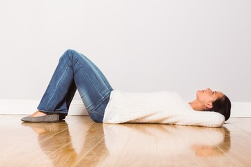 Young woman lying on floor thinking