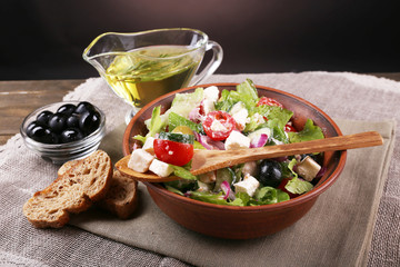 Bowl of Greek salad served with olive oil