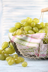 Ripe grapes in metal basket with napkin