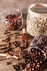 Glass jars and spoon with coffee beans