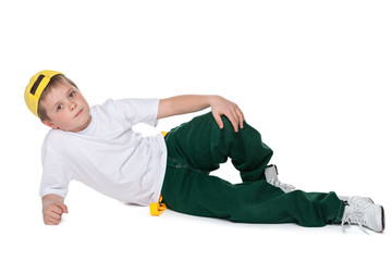 Fashion handsome young boy is lying on the white