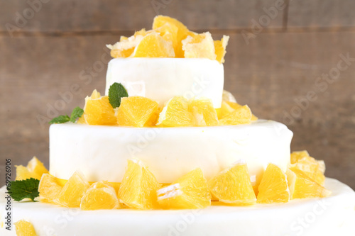 canvas print picture Beautiful wedding cake with oranges on  wooden background