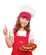 happy little girl cook with spaghetti and thumb up