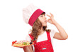 little girl cook enjoying a delicious spaghetti
