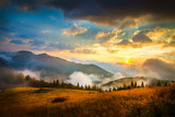 Amazing mountain landscape with fog and a haystack - 69928595