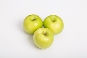 Three Granny Smith Apples on White Counter