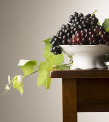 grapes with leaves on the table