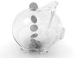 glass piggy bank and falling coins