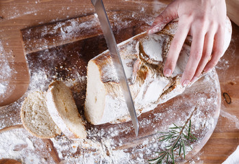 Hand cutting bread