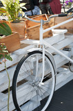 Vintage decoration bicycle standing near wooden boxes.
