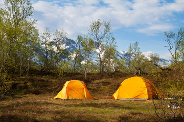 two tourist tents in mountains