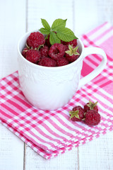 raspberries in white cup