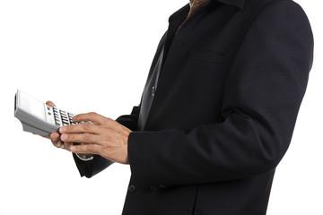 Businessman using a calculator