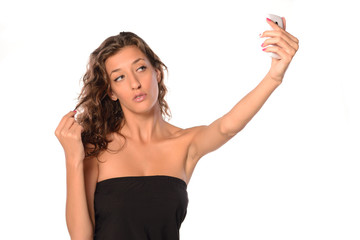 Young woman making selfie on white isolated background