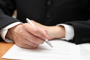 Businessman viewing the contract before signing