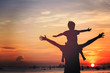 canvas print picture - father and son on sunset beach
