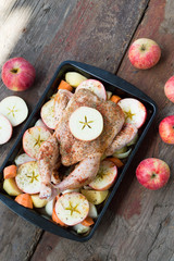 Roasted chicken with apple and vegetables