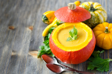 Pumpkin soup in a pumpkin copy space background