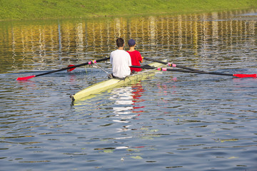 Two rowers in a boat