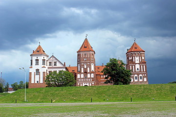 Mir Castle on the background of a stormy sky