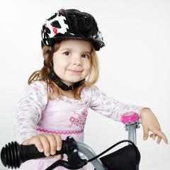 Cute girl on a bike
