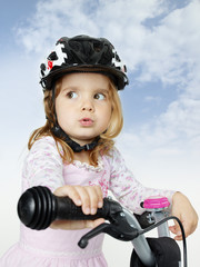 Cute girl on a bike outdoors