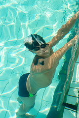 Boy underwater from above view