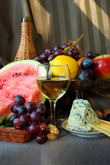 Fruit, cheese and a glass of wine.