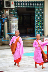 Young Buddhist woman ascetic or nun walking go to study