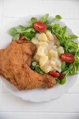 Gebackener Hühnerschenkel mit Salat