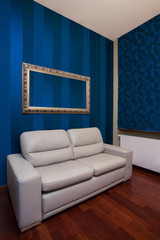 Sofa in room with blue walls