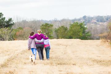 Family Girls Walking Hugging Outdoors Landscape