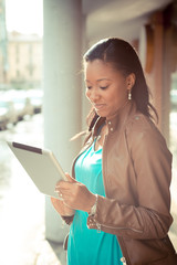 beautiful african young woman using tablet