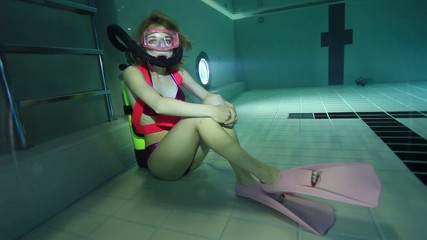 Female scuba diver underwater in the pool
