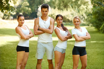 Group of friends in sportswear at the park