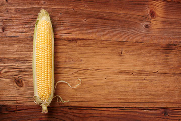 corn on the cob on wooden background