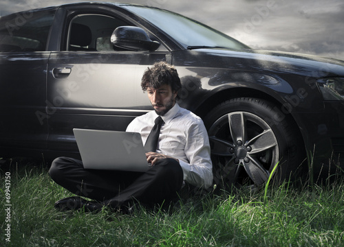 canvas print picture Businessman writing on his pc