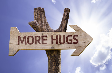 More Hugs wooden sign on a beautiful day