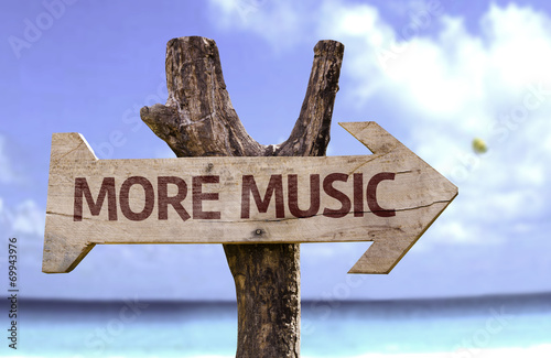 More Music wooden sign with a beach on background