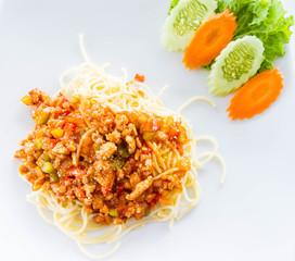 bolognese spaghetti on white plate