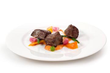 tre cubi di carne al forno