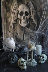 Halloween background with  tombstone, scull, candles,