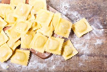 Raw ravioli with flour