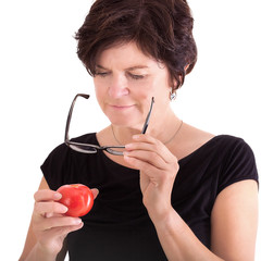 Woman checking tomato